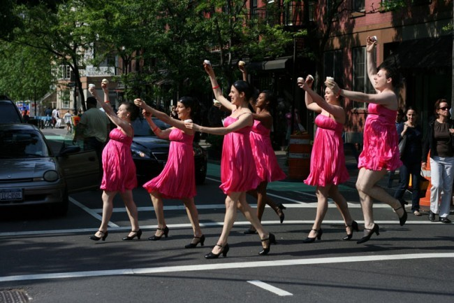 Cupcake Cadet Corps members Becka Vargus, Emily Wassyng, Sheiline McGraw, Marla McReynolds, Summer Brown, and Joseph Schles charge across Bleecker Street in West Village