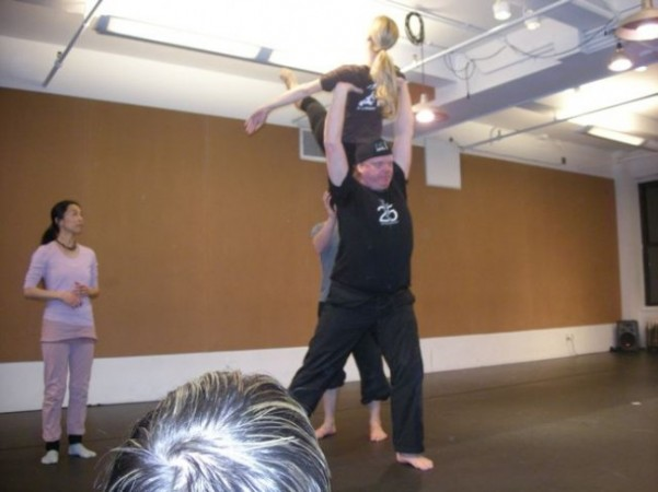 Leon Ingulsrud SITI actor practices his lift with Jennifer DePalo while Miki Orihara spots.