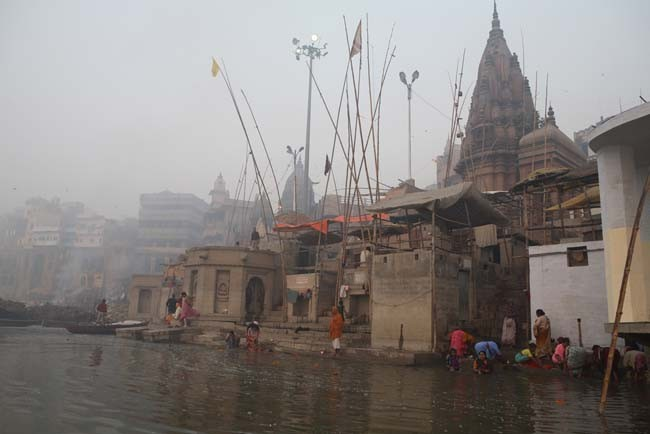 Early morning view of people washing in the Ganges.