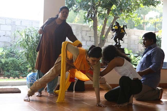 Anita Ratnam at home with her team: dramaturg, tailor and personal assistant. She is rehearsing her 5 costume changes for Faces... blessed unrest.  The work premiered at the Krishna Gana Sabha Theater in Chennai on December 28, 2007.