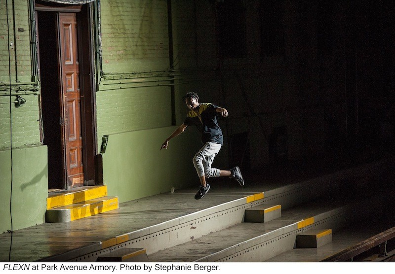 A FLEXN dancer leaps from the stairs on the expansive Park Avenue Armory stage