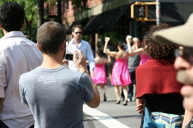 Cupcake Cadets disappear into the crowd of tourists and shoppers on Bleecker Street