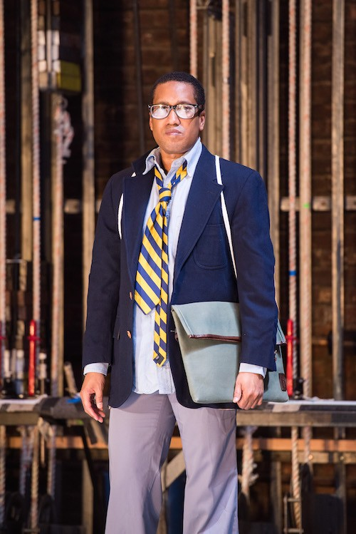 Trajal Harrell in glasses and preppy suit with a loosened tie