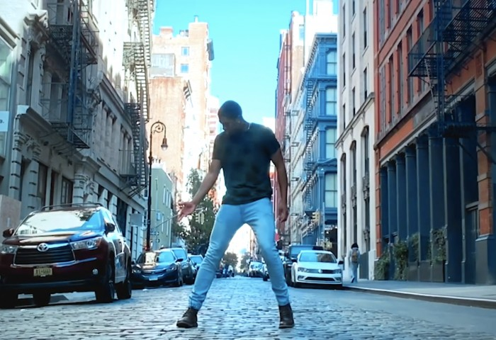 Christopher Grant dances on a New York street