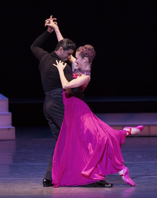 Rebecca Krohn in a fuchsia dress and pointe shoes. Amar Ramasar holds her in an embrace