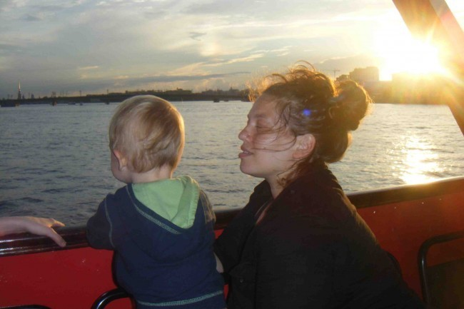 Alexandra and her son enjoy a boat ride after her workshop