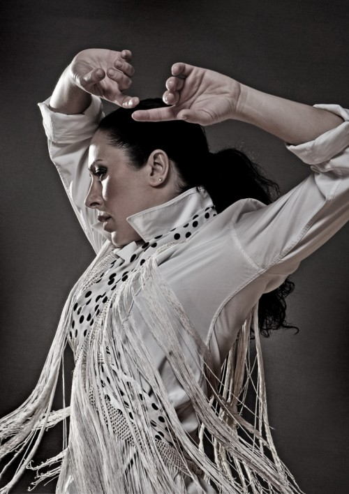 Flamenco Dancer Sonia Olla strikes a pose with her arms over head
