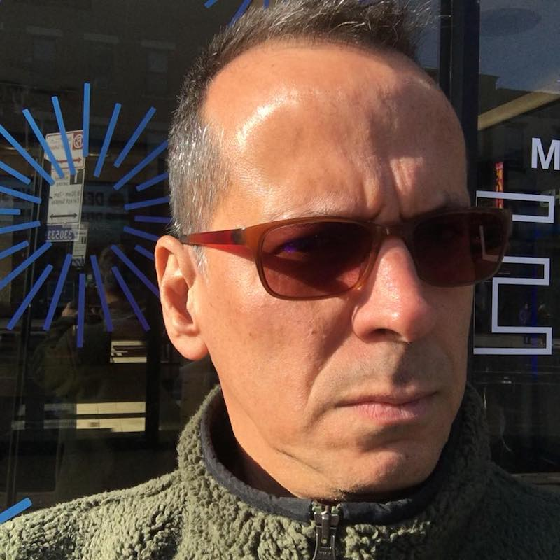 An informal headshot of Fernando Maneca wearing sunglasses