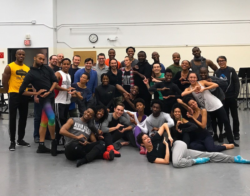 The entire Ailey company pose for a group shot after rehearsal