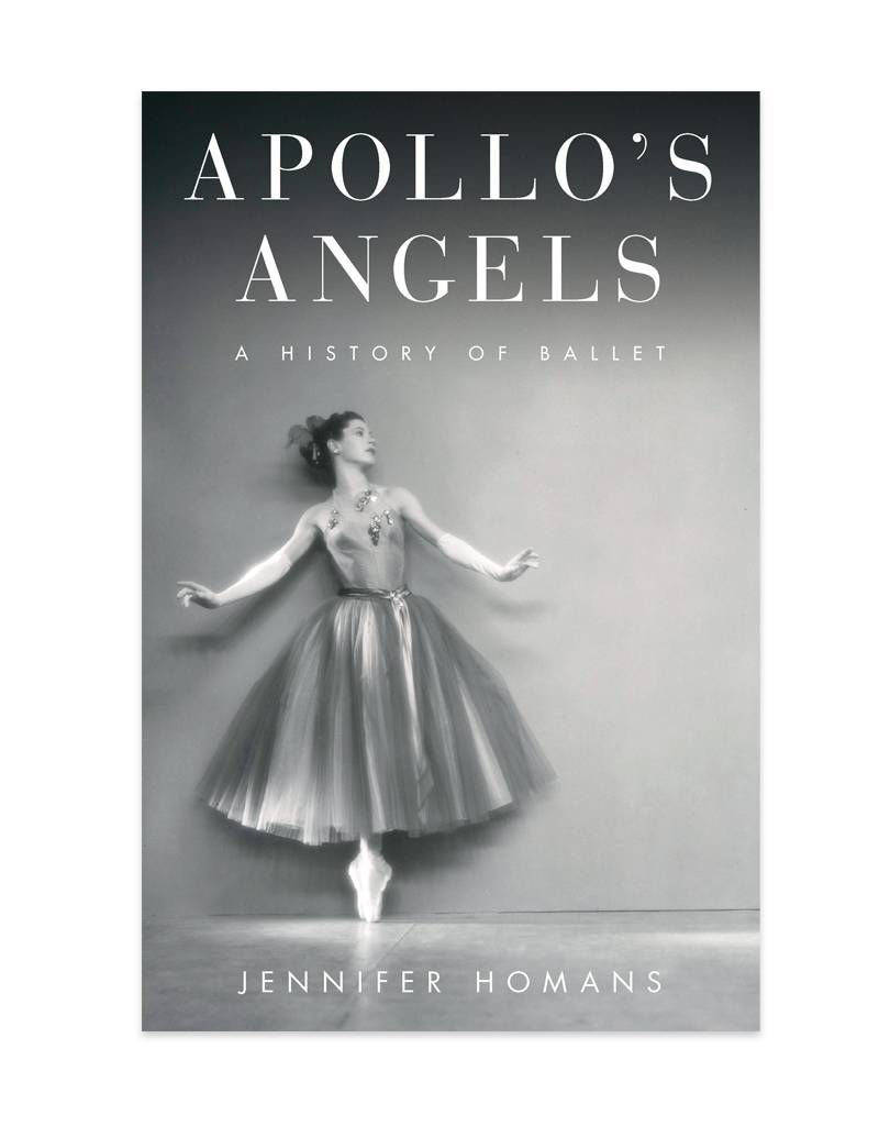 The book jacket for Apollo's Angels. A ballerina is on pointe with her arms outstretched. Her full tutu grazes her ankles.