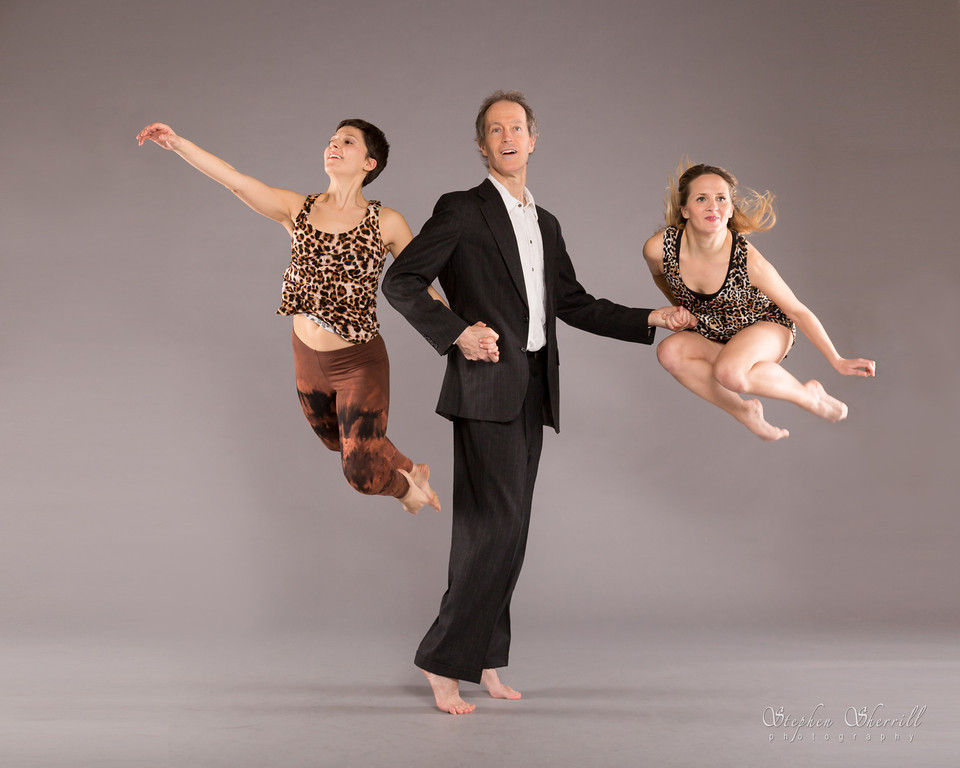 Stephen Kelley, Co-Director and Co-Founder, flanked by dancers in flight