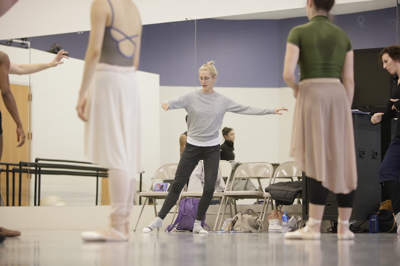 Gemma Bond demonstrates in jeans and socks in a rehearsal to dancers in leos, long tutus and pointe shoes