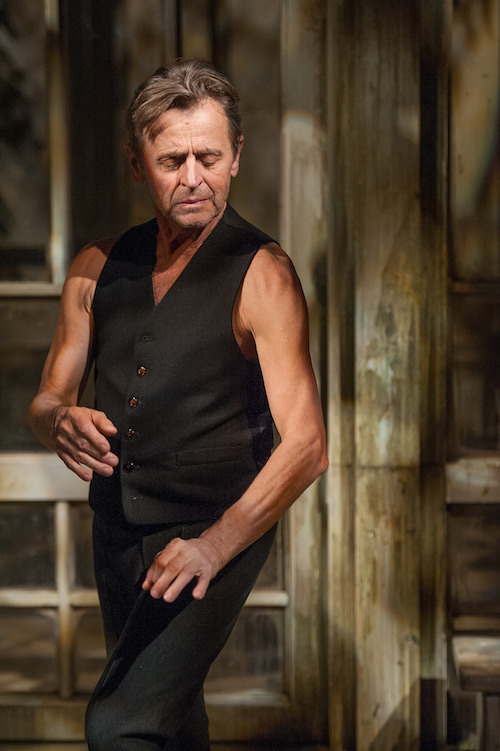 Baryshnikov with his eyes closed as his fingers appear to do a dance all of their own.