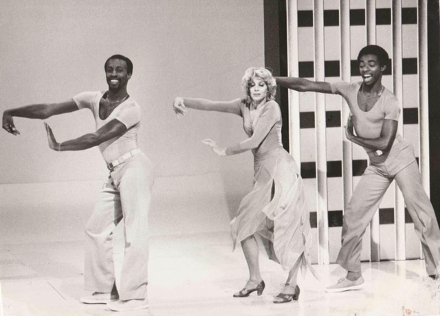 Bruce Heath and dancers in mid strut on the set of a 1970s television show
