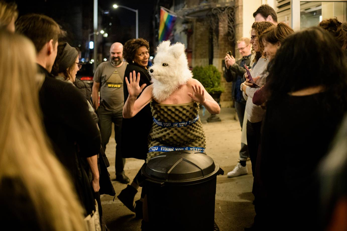 Woman in wolf head surprises crowd outside theater