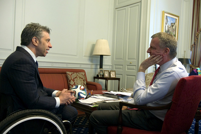 Victor Calise in a wheel chair with Mayor De Blasio