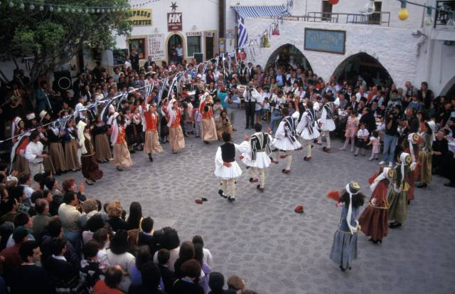Greek folk dancers in a public square in Greece
