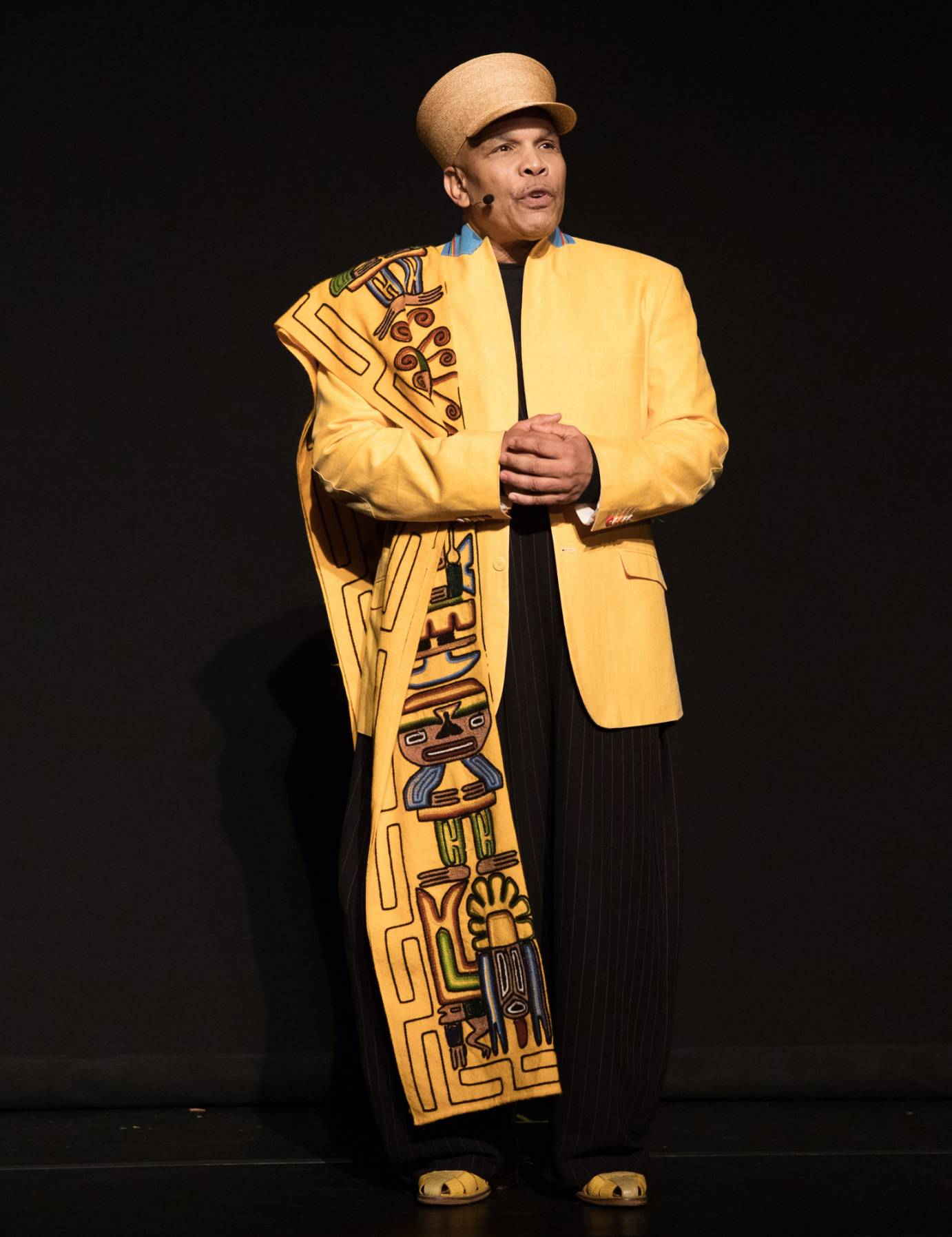 Abdel Salaam in a hat and beautiful yellow embroidered coat