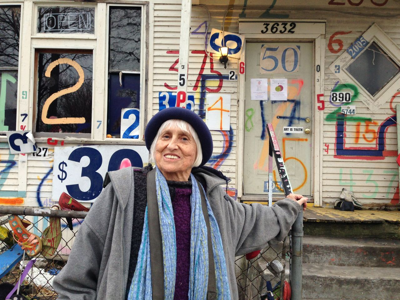 Harriet Berg in front of Detroit's Heidelberg Project