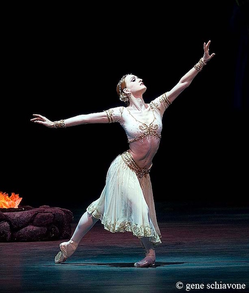 Gillian assumes a deep lunge position in a white beweled costume from the Ballet La Bayadere