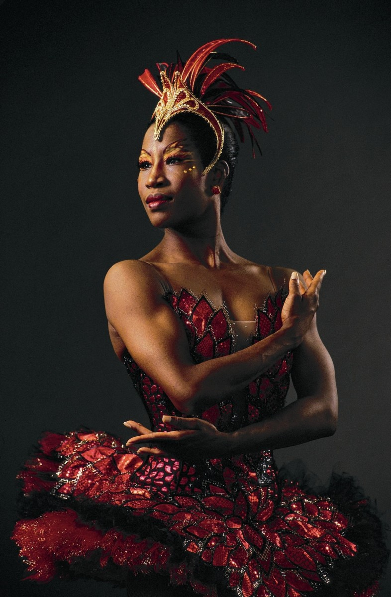 Lauren Anderson in a Firebird red tutu and headpiece. Her arms cross across her chest