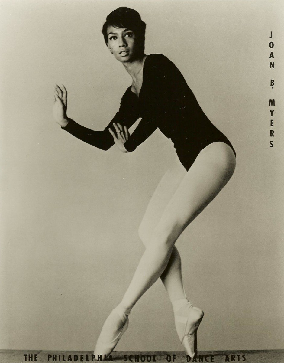 A picture of a Young Joan Myers Brown on pointe wearing a black leotard and light-colored tights