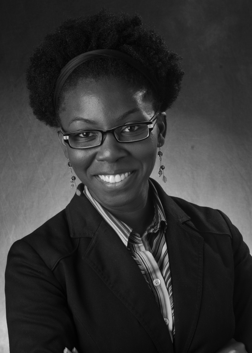 Headshot of Dr. Amma Y Gartey-Tagoe Kootin who is wearing a blazer, glasses and striped collared shirt