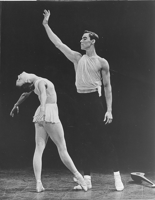 A young Jacque d'Amboise in Balanchine's Apollo with a fellow ballet dancer who wears a white leotard and skirt and is executing a back bend