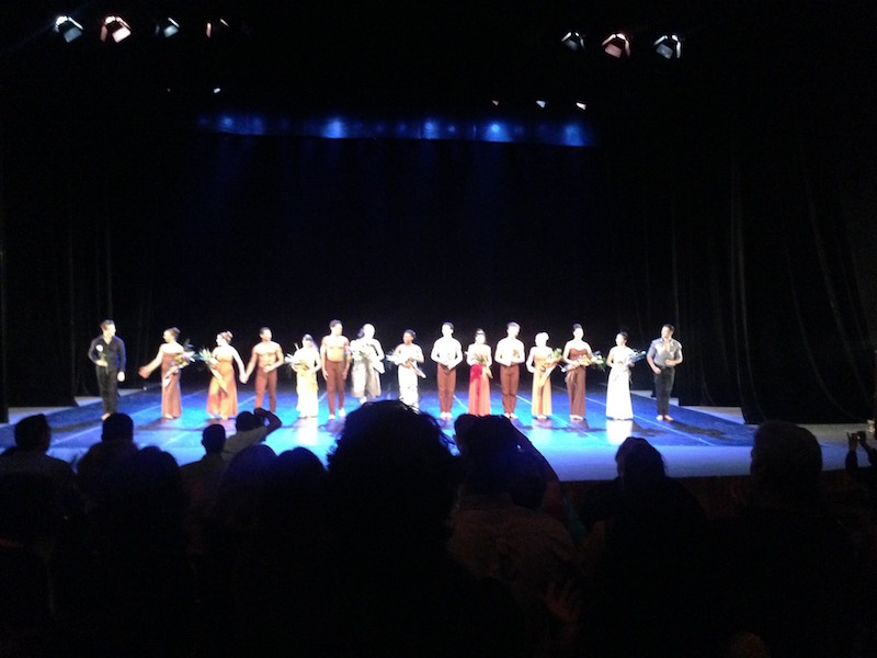 Graham Dancers hold flowers and bow on the stage of Teatro Mello