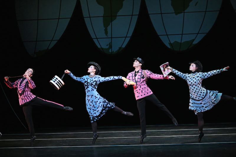 A quartet wearing pink and blue pastel overcoats and black pointe shoes