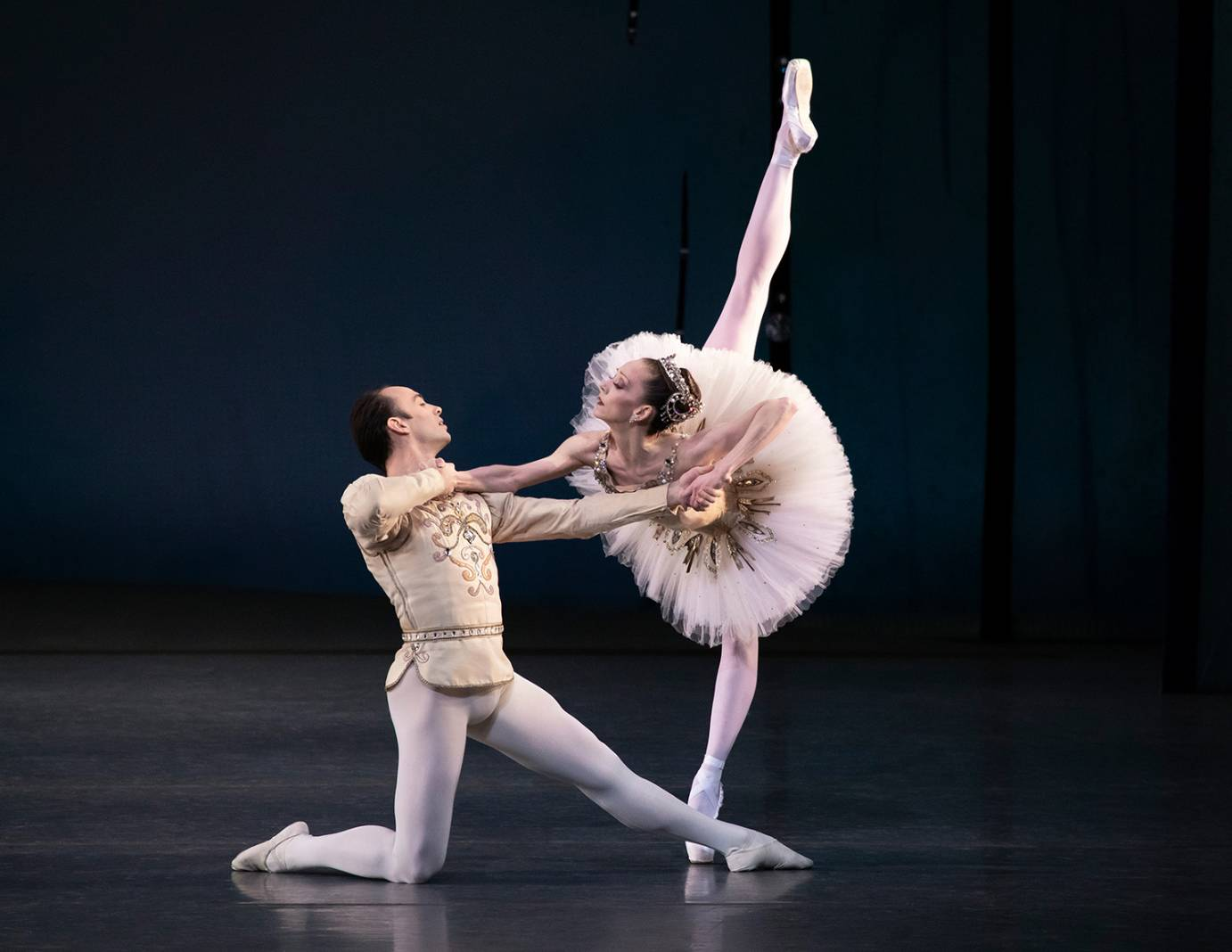 Tyler Angle partners Maria Kowroski, who's in a deep arabesque