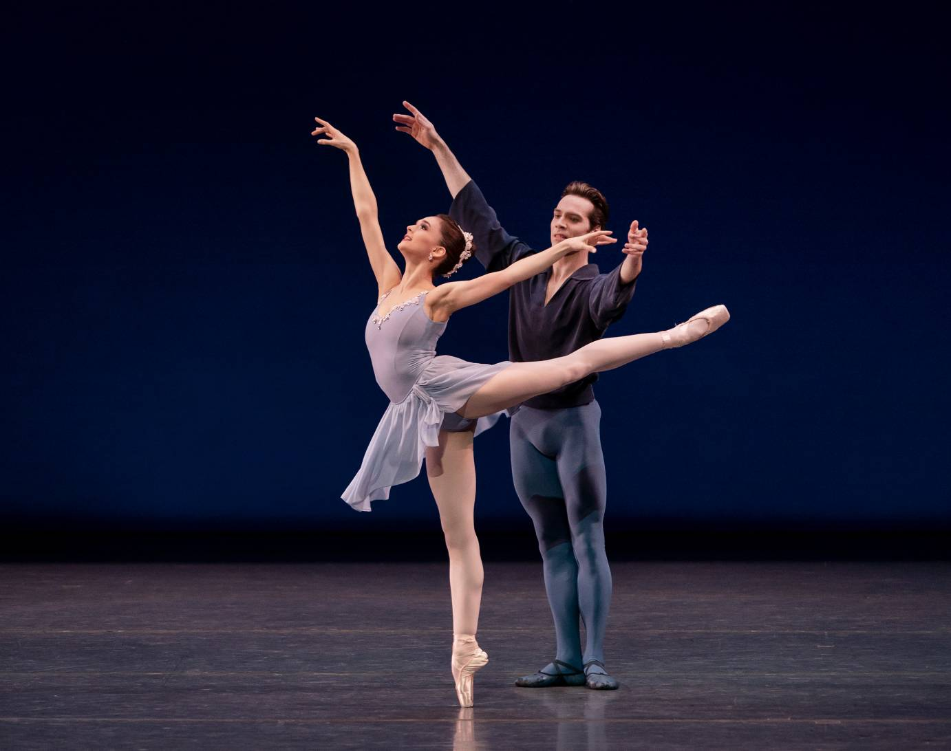 A man partners a woman in arabesque