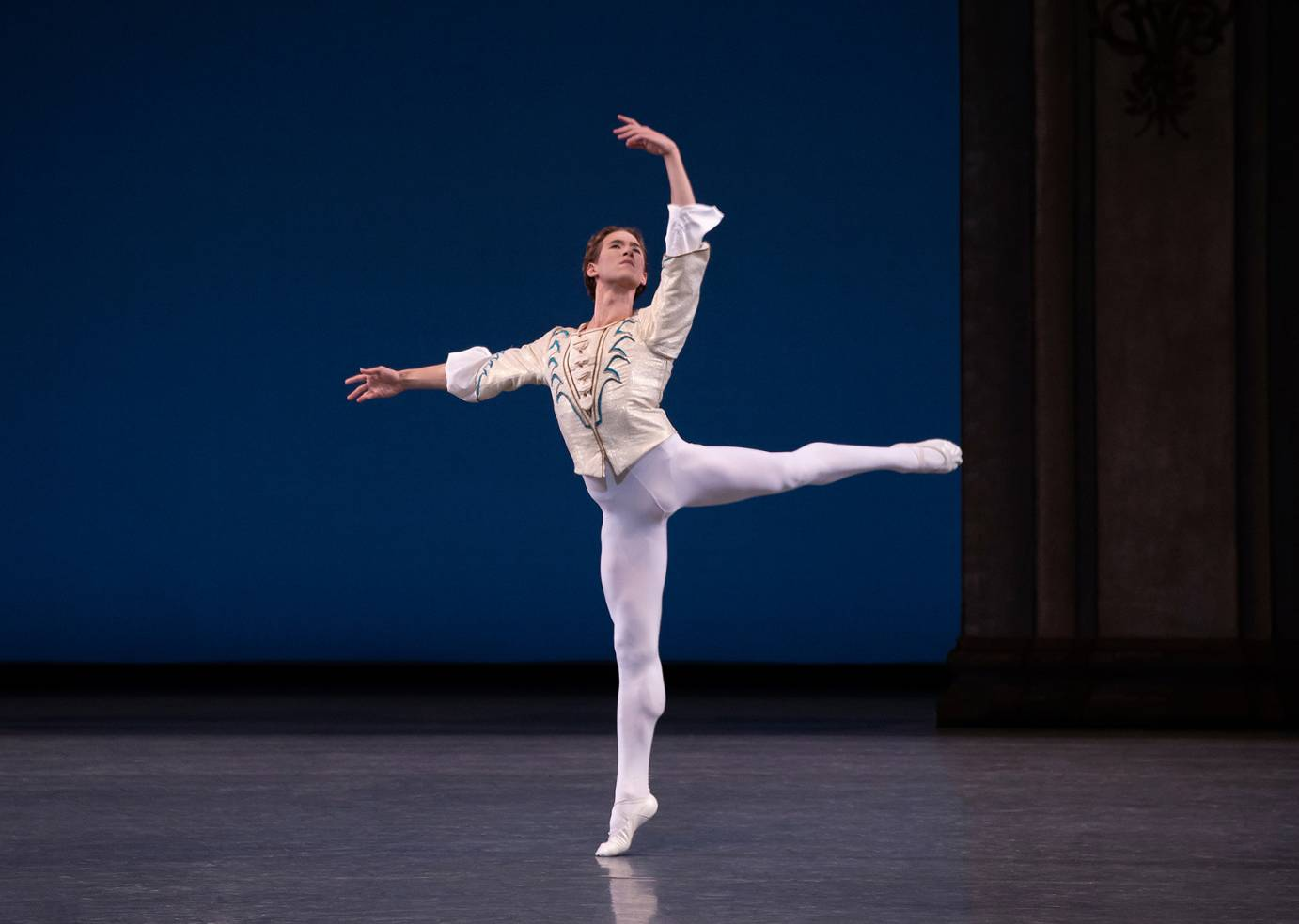 Joseph Gordon balances in an arabesque, one arm rounded overhead, the other extended to the side