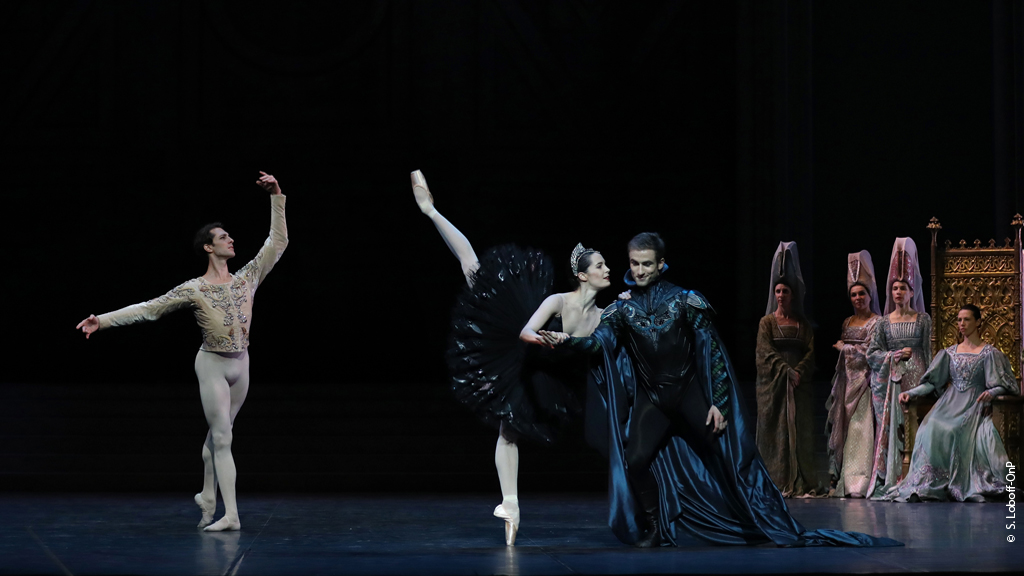 Odile penchees with von Rothbart as Prince Siegfried assumes a classical tendu derriere