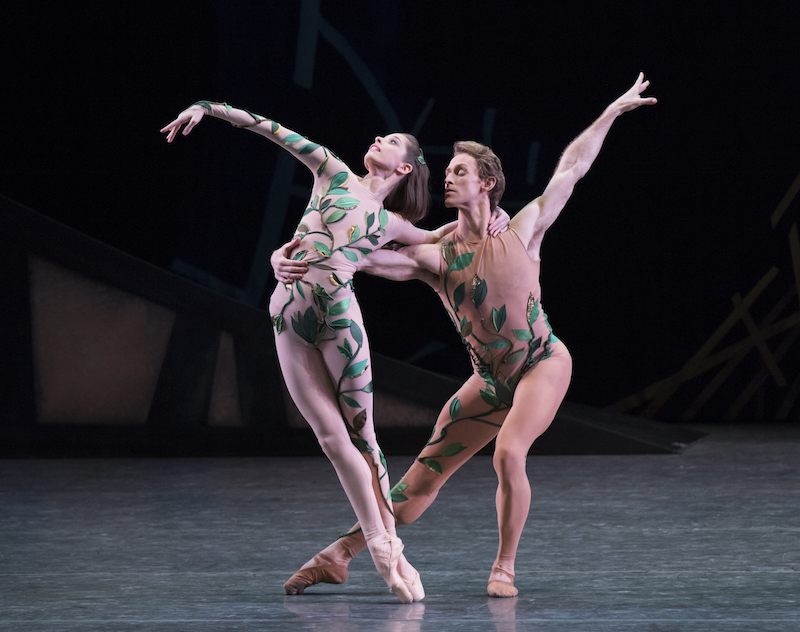 Dressed in nude unitards with green vines, Rebecca Krohn is en pointe while her partner Adrian Danchig-Waring holds her by the waist. She leans away from him