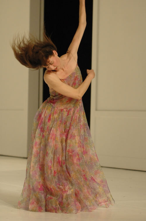 Helena Pikon swipes her arms through the air. Her hair cascades around her head in response.