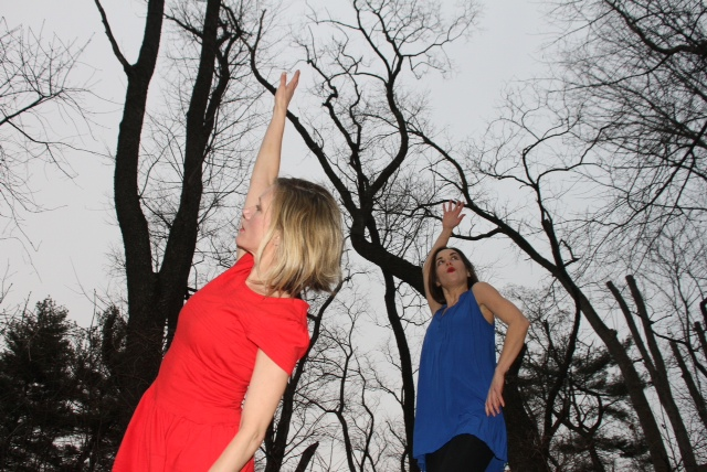 The duo of the Raving Jaynes improvise outside amongst the trees wearing red and blue tops