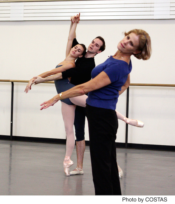 Merrill Ashley leads a couple in a pas de deux. Jonathan Stafford supports Tiler Peck as she extends into a long arabesque.