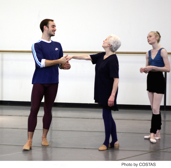 Tyler Angle takes Violette Verdy's outstretched hand as NYCB dancer Janie Taylor observes.