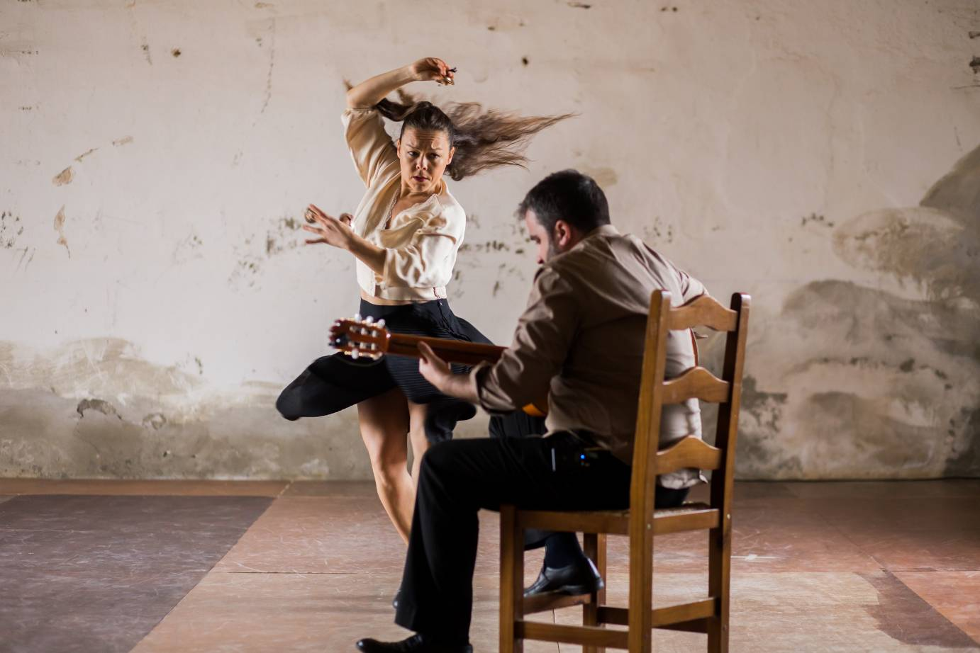 Rocio Molina dances with abandon close to the flamenco guitarist