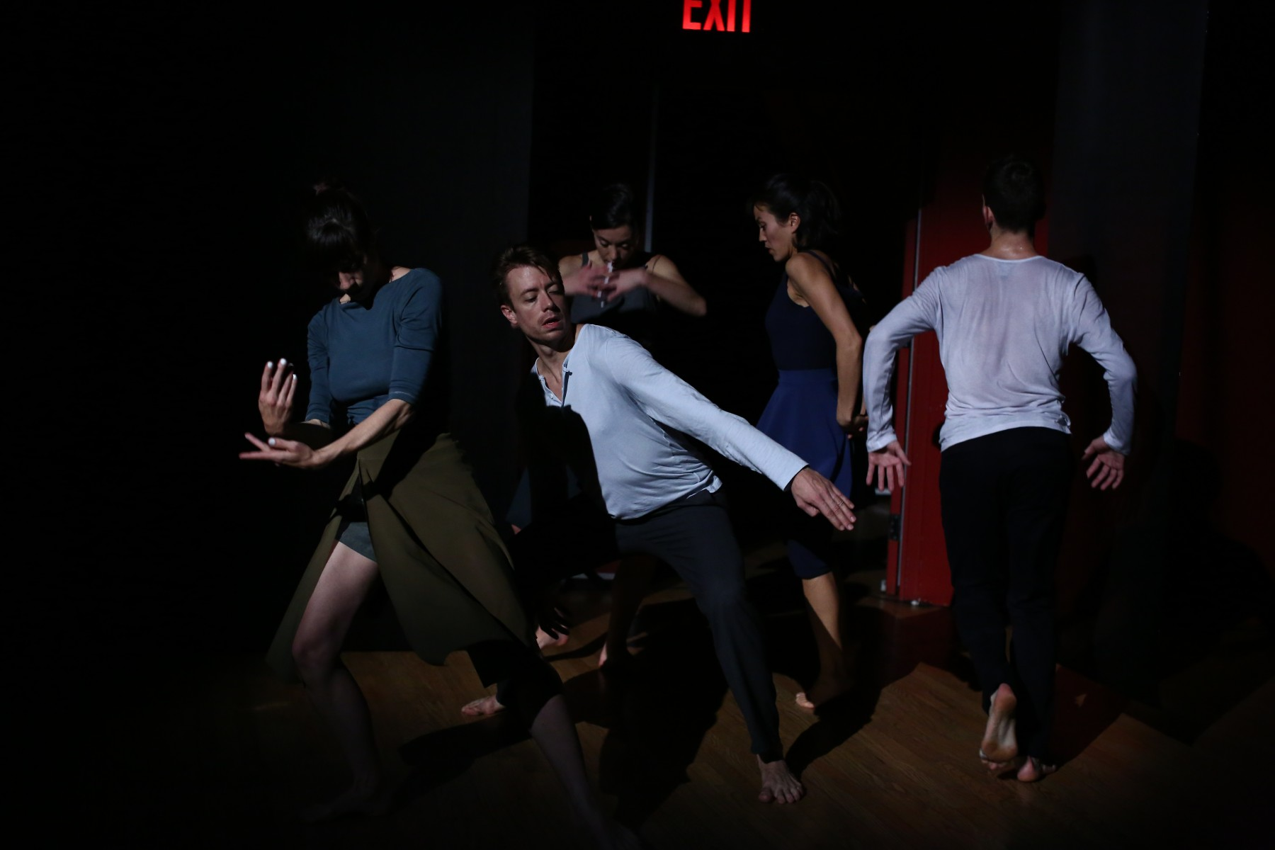 Sally Silver's cast dances in a tight clump in the shadows