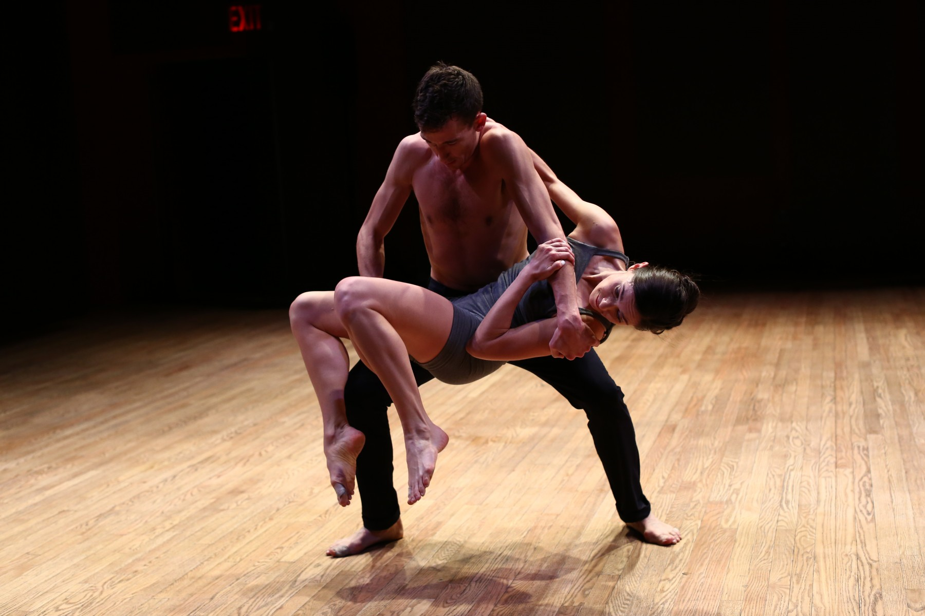 Dancer Dylan lifts dancer Melissa Toogood in a duet inspired by Hitchcock's North by Northwest