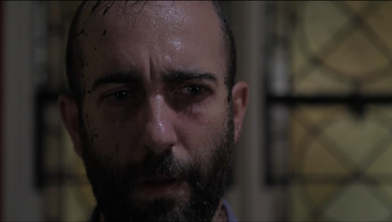 A close up of actor Andrew Dinwiddie's face. He's sweating and has a look of trepidation.