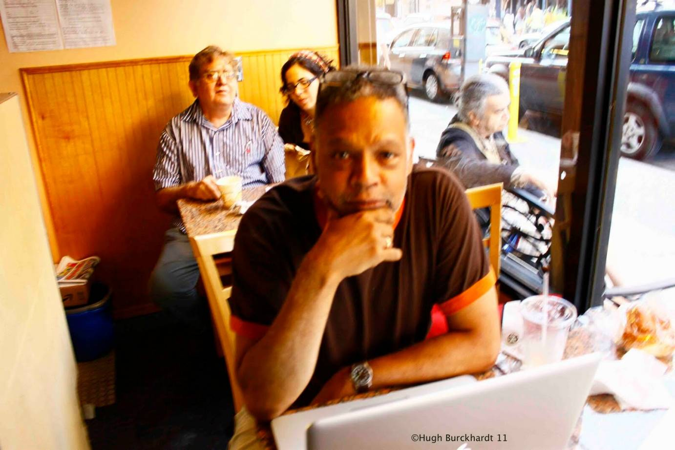 Ishmael Houston-Jones working on a laptop at a New York coffee shop.