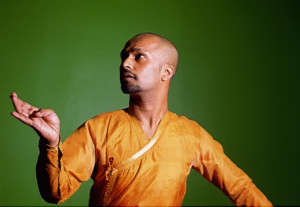 Akram Khan in a classical Indian dance pose.