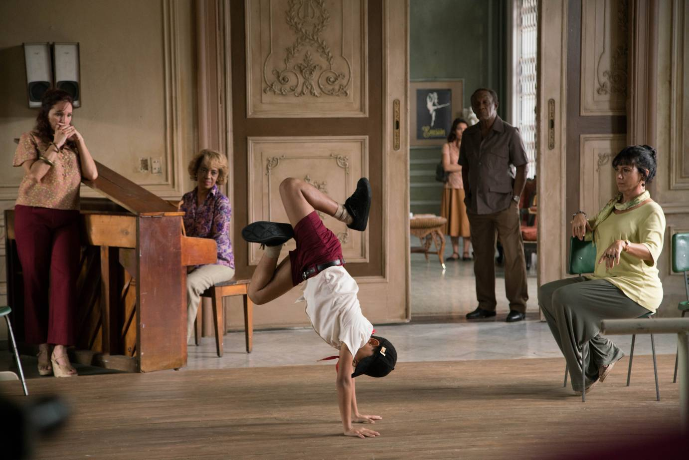 Carlos Acosta breakdancing in front of people in the movie version of his life